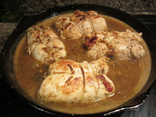 chicken cooking in sauce